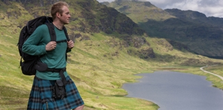 Man walking in the hills of Loch Lomond